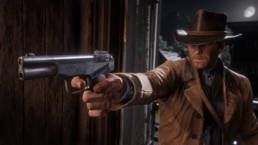 A cowboy with a large hand cannon in Red Dead Redemption 2