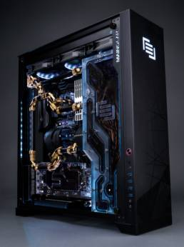 A Maingear F131 with black and gold tubing and fittings.